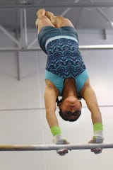 Story Laing, 13, practices on the uneven bars at the Licking County Family YMCA's Mitchell Center. She tied for fifth in Level 7 at the YMCA National Championship earlier this summer.