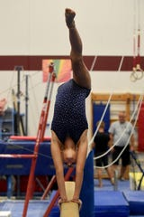 Kennedi Orcutt, 12, practices the balance beam at the Licking County Family YMCA's Mitchell Center. Orcutt was a Level 4 Juniior Division champion in the YMCA National Championship earlier this summer.
