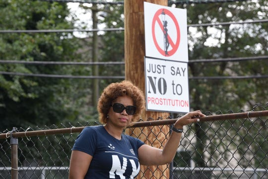 "Cheryl Holman had ""Just say no to prostitution"" signs posted on telephone poles on Van Houten Street in Paterson"