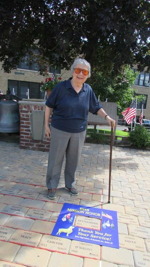 Artist and member of the Butler High School Class of 1947 Bea Card Kettlewood is seen at the BHS Mission Honor Veterans Park showing a paver for late husband Jim Kettlewood who served in the Military during World War II.
