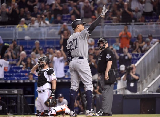 New York Yankees left fielder Giancarlo Stanton (27) acknowledges the crowd while batting in the first inning for the first time against his former team the Miami Marlins at Marlins Park.