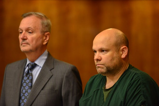 Defense attorney, Joseph P. Rem, Jr., stands next to his client Shawn Kelly during the detention hearing before Judge Justine Niccollai, in Paterson on Tuesday August 21, 2018.