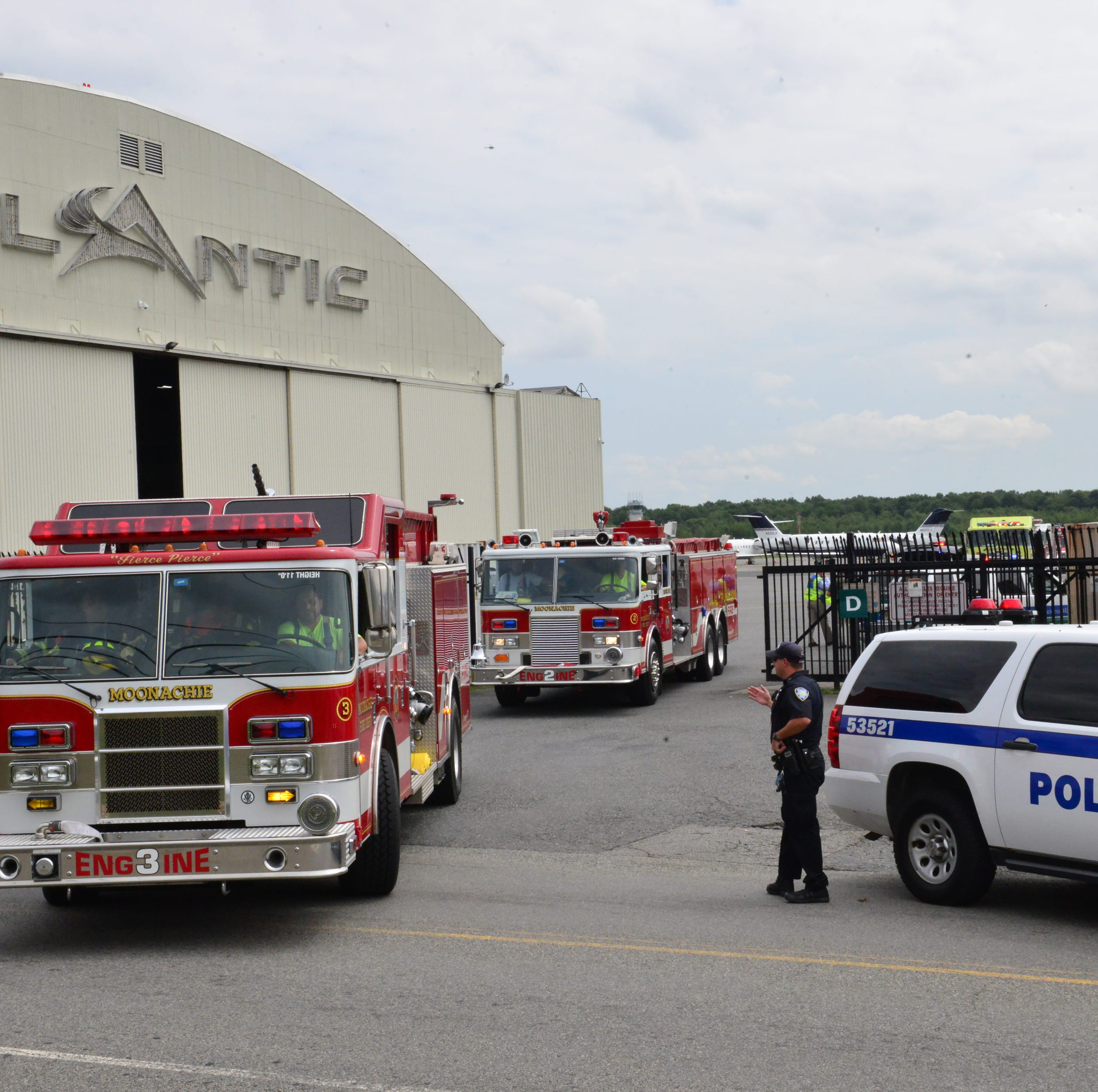 Emergency personnel at Teterboro Airport as they expect a plane to land with flat tires in Teterboro on Tuesday August 21, 2018. The plane was diverted to an airport in Massachusetts.