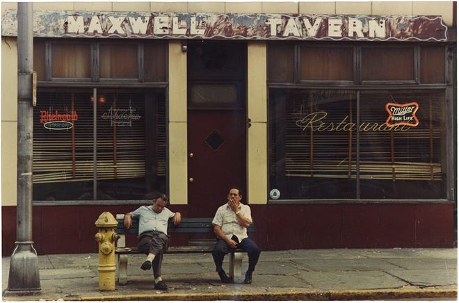 Two men sit outside Maxwell's Tavern in 1974, when it served workers of the coffee plant nearby.