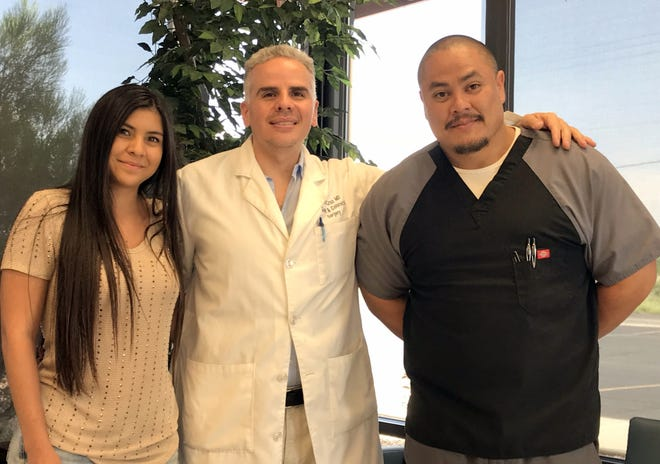 Pictured from left are: Melissa Astorga, receptionist; Dr. Victor Cruz and Fernando Arvizo, medical assistant.