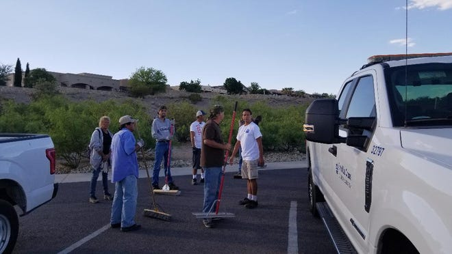A group from the Mano y Mano program help the Las Cruces Parks & Recreation Department with a beautification project.