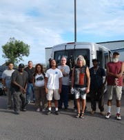 A group photo of participants in Mano y Mano,  a pilot work program for people experiencing homelessness.