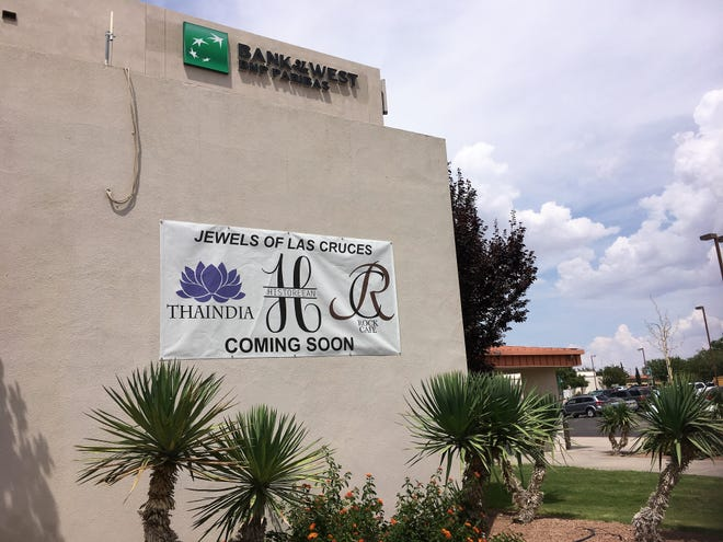 A canvas sign announces on Aug. 21, 2018 the future arrival of three restaurants in the heart of downtown Las Cruces.