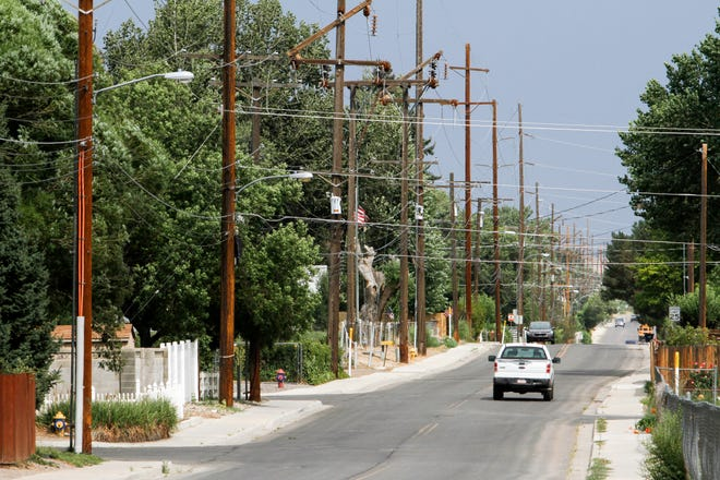Overhead power lines is pictured, Tuesday, Aug. 21, 2018  along West Blanco Boulevard in Bloomfield.