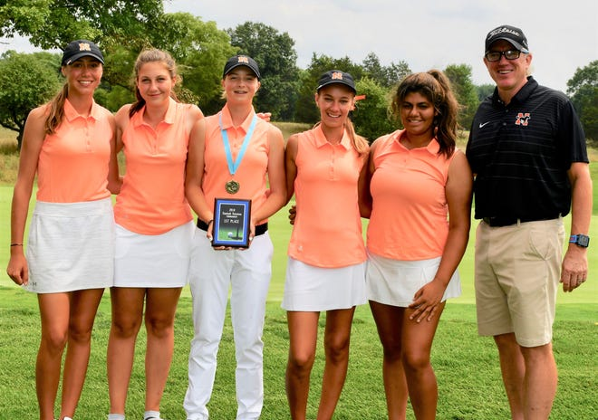 The Northville girls golf team shattered the school record with a 291 winning the Sentech Services Invitational Aug. 20 at Kensington Metropark.