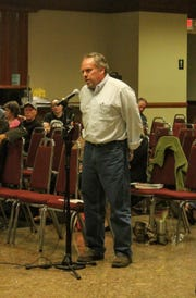 Livonia resident Bruce Tenniswood gives his public comment to the DEQ at the public meeting Aug. 20 at Burton Manor.