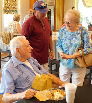 Jack Van Eaton, 91, speaks with well-wishers on Sunday during a reception for him held at the home of Eddie and Cheryl Villemarette in the LeBeau area.