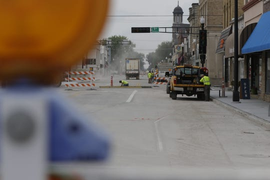 Crews work to reconstruct Oregon Street on Monday, August 20, 2018, in Oshkosh.