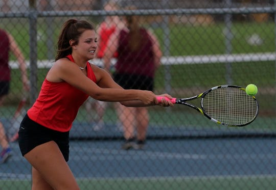 Lourdes Academy's Maria Tushar returns a hit during her doubles match.  Lourdes Academy Knights played host to Mayville Cardinals in WIAA girls tennis Tuesday,  August 21, 2018, in Oshkosh, Wis.