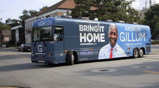 Andrew Gillum's campaign bus turns onto North Spring Street during a campaign stop in Pensacola on Tuesday, Aug. 21, 2018.