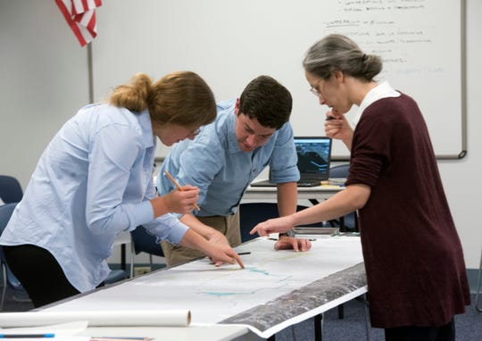 Gena Wirth, Chris Barnes and Lee Altman with SCAPE Landscape Architecture DPC work Aug. 21 on a vision for how to revitalize Pensacola's waterfront before a presentation to the community as part of the CivicCon speaker series.