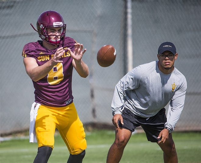 Arizona State University quarterback Kurt Walding takes a snap at practice in Tempe, Tuesday, August 21, 2018.
