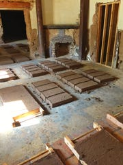 New adobe bricks created to restore Monti's La Casa Vieja dry.