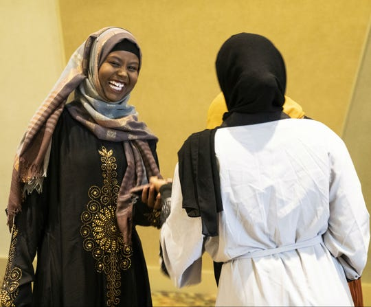 Sulekha Musse laughs with her friends while awaiting the Eid prayer on Aug. 21, 2018, in Phoenix.