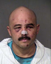 Juan Arizmendi in a booking photo from 2014.
