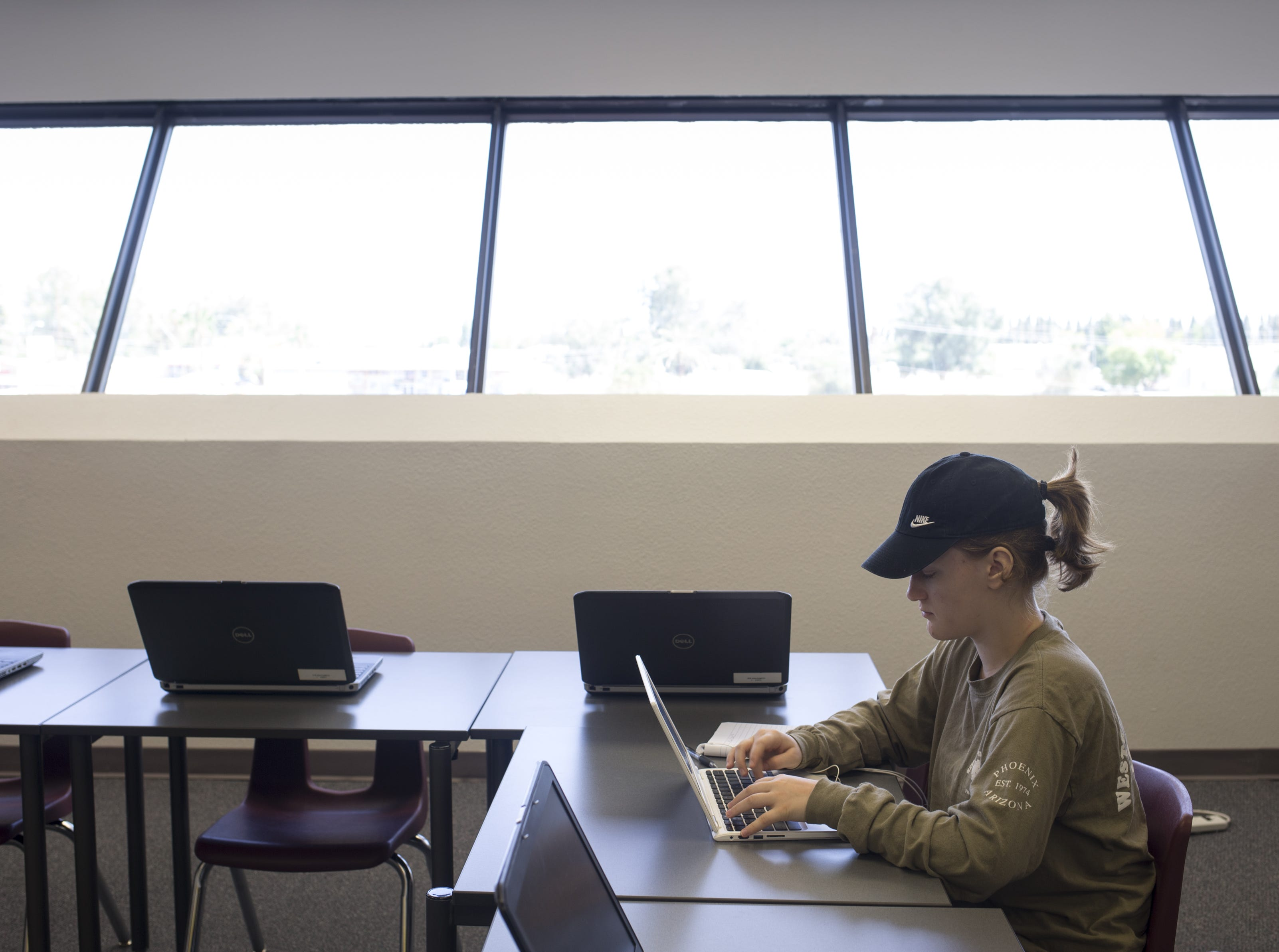 Leilene Pyper works in the open computer lab in the Mesa Public Schools Student Services building on Aug. 1, 2018.