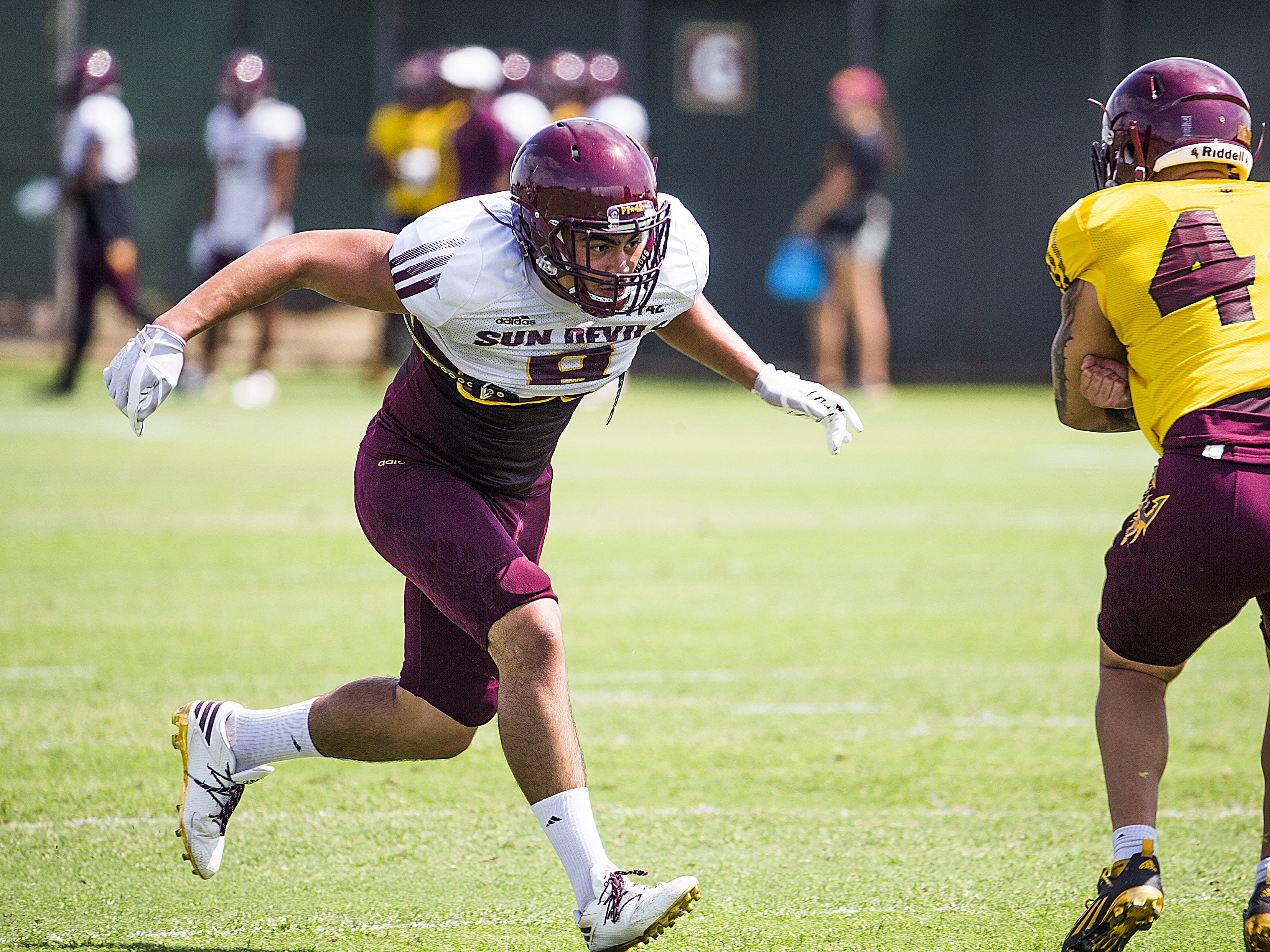 Arizona State University linebacker Merlin Robertson, left, runs during practice in Tempe, Tuesday, August 21, 2018.