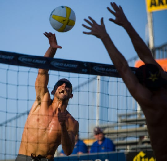 Nick Lucena spikes the ball during a match at the AVP Best of the Beach professional volleyball tournament  in Glendale on Sept. 26, 2008. The tournament was played in the Westgate Entertainment District for a few years.