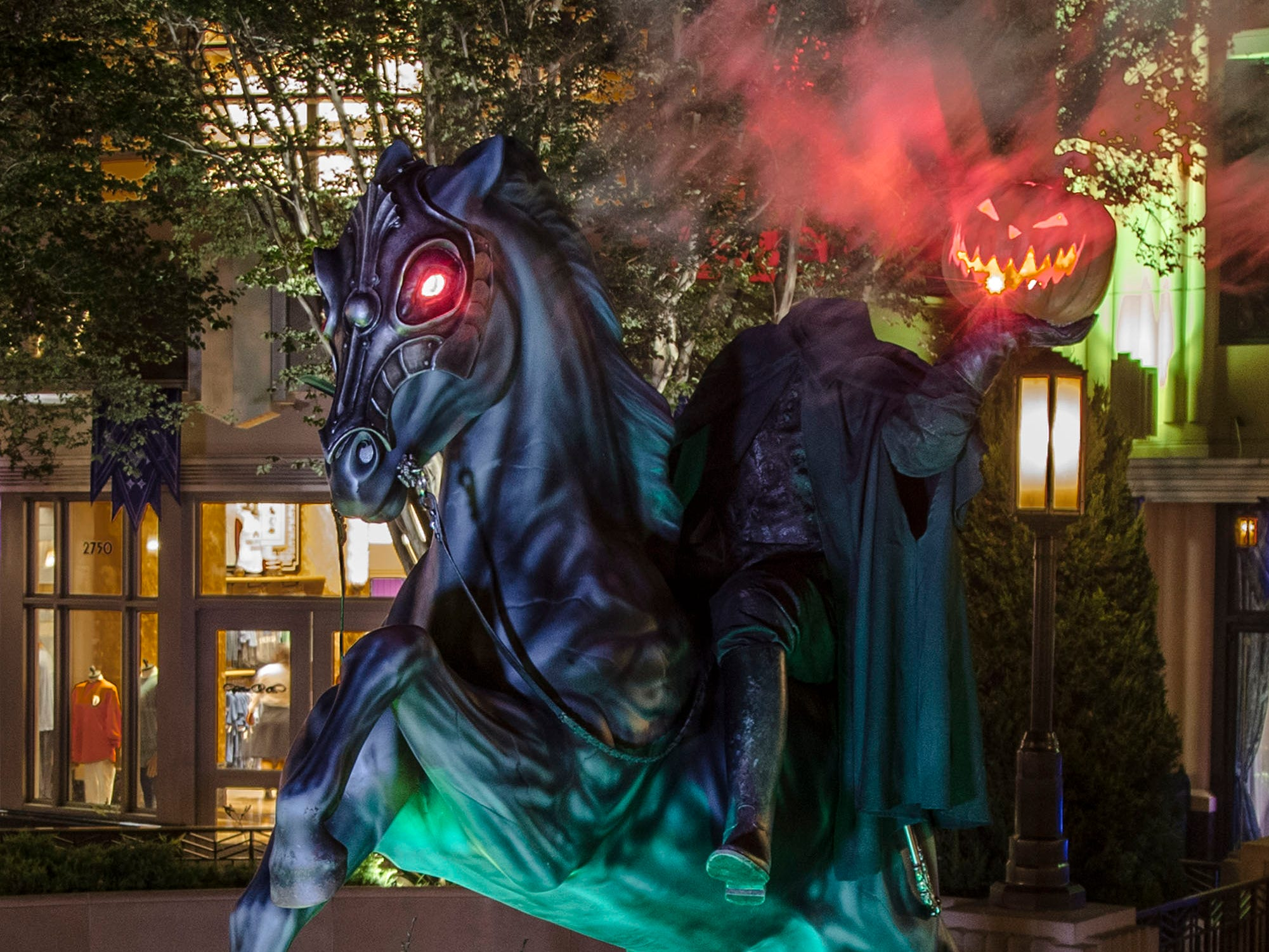 On Buena Vista Street at Disney California Adventure, guests will see a 10-foot-tall statue of the Headless Horseman, holding his jack-o'-lantern head to the sky.