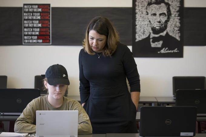 Margarita Castillo (right) works with Leilene Pyper in the open computer lab in the Mesa Public Schools Student Services building on Aug. 1, 2018.