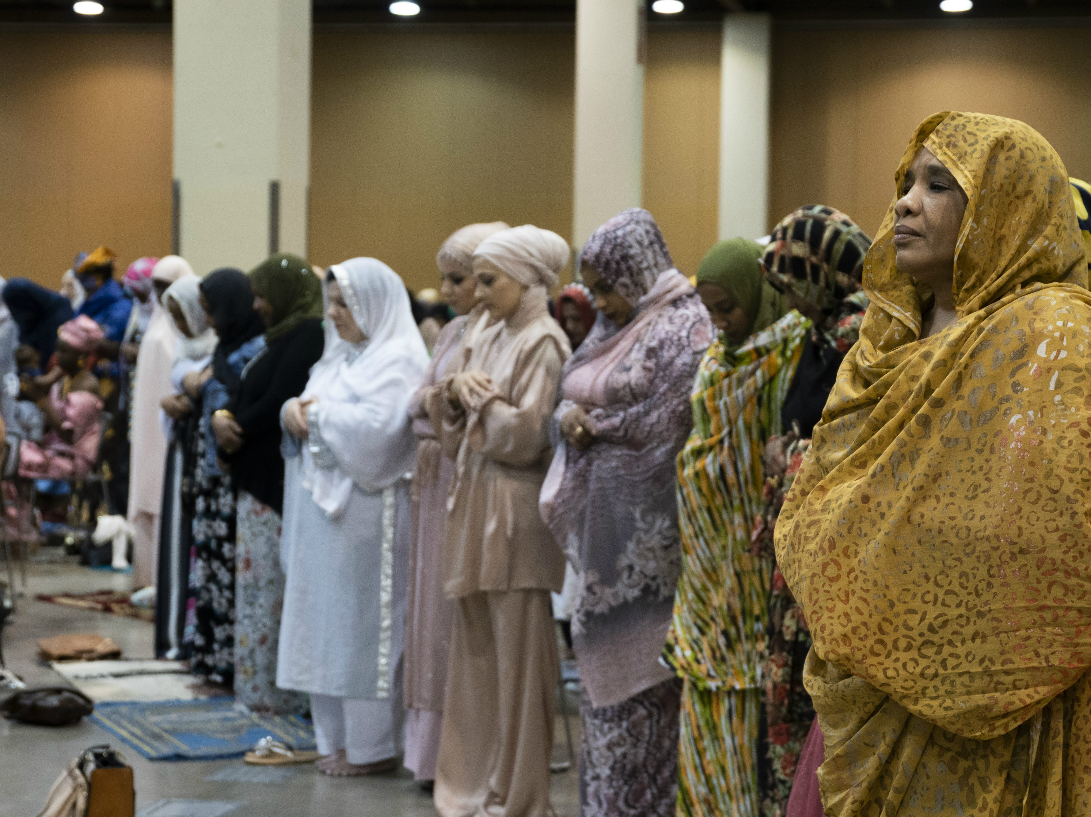 Women pray at an Eid celebration on Aug. 21, 2018, in Phoenix.