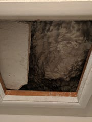 Green knew that she would need to upgrade her insulation in her attic, and she used a spray foam to do it, as seen through her crawl space entry in her master closet.