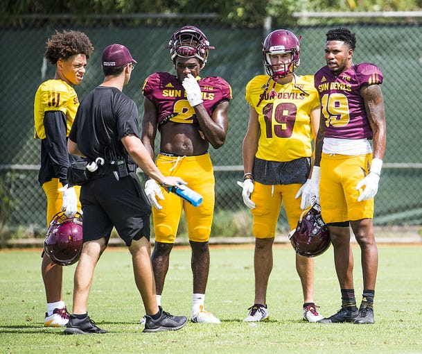 Arizona State University wide receiver Terrell Chatman, right, takes a break during practice in Tempe, Tuesday, August 21, 2018.