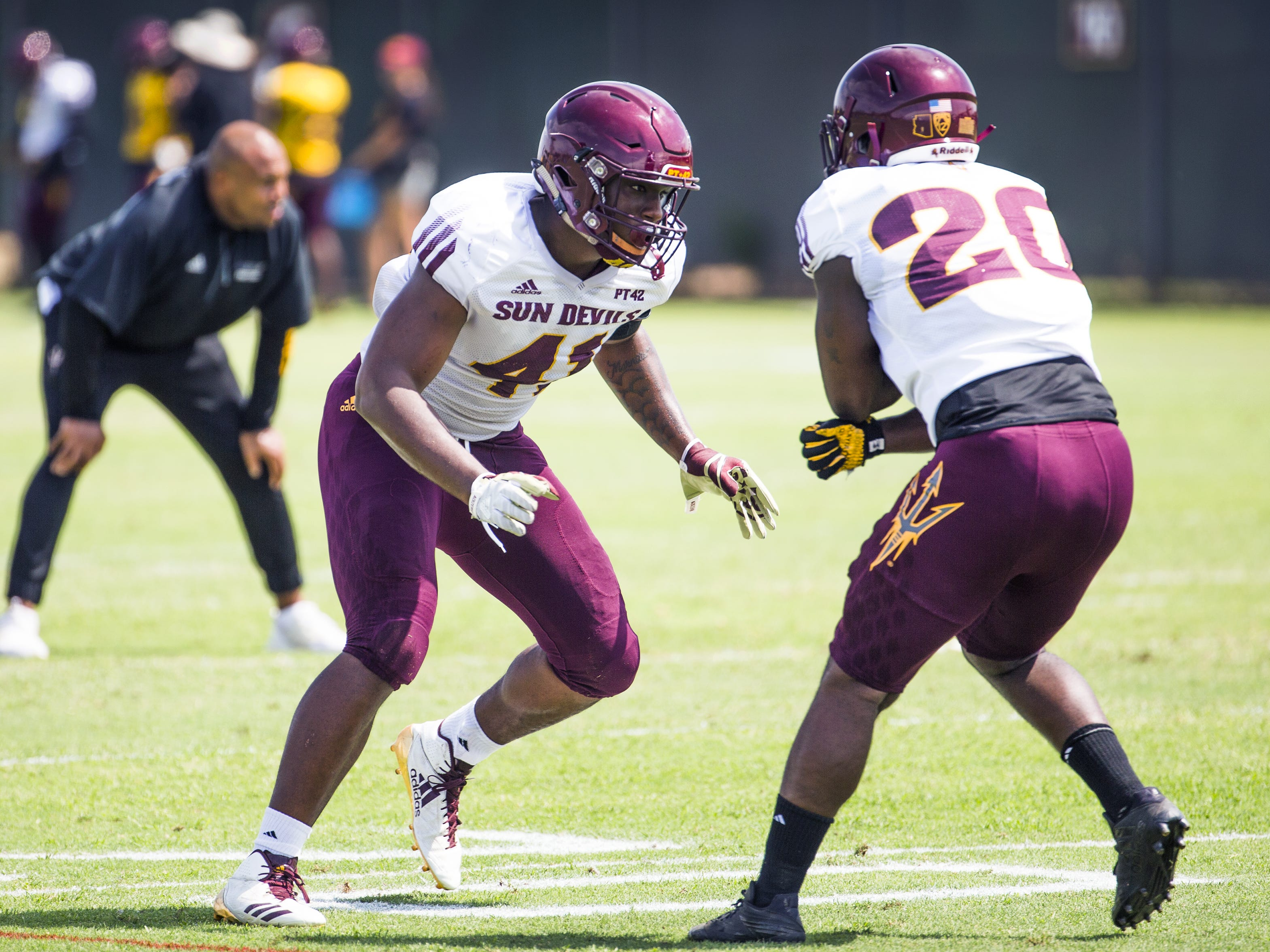 Arizona State University dlinebacker Tyler Johnson, left, rushes linebacker Kaylan Kearse-Thomas, right, at practice in Tempe, Tuesday, August 21, 2018.