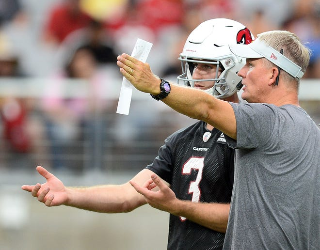 Arizona Cardinals quarterback Josh Rosen (3) talks with offensive coordinator Mike McCoy during training camp at University of Phoenix Stadium.