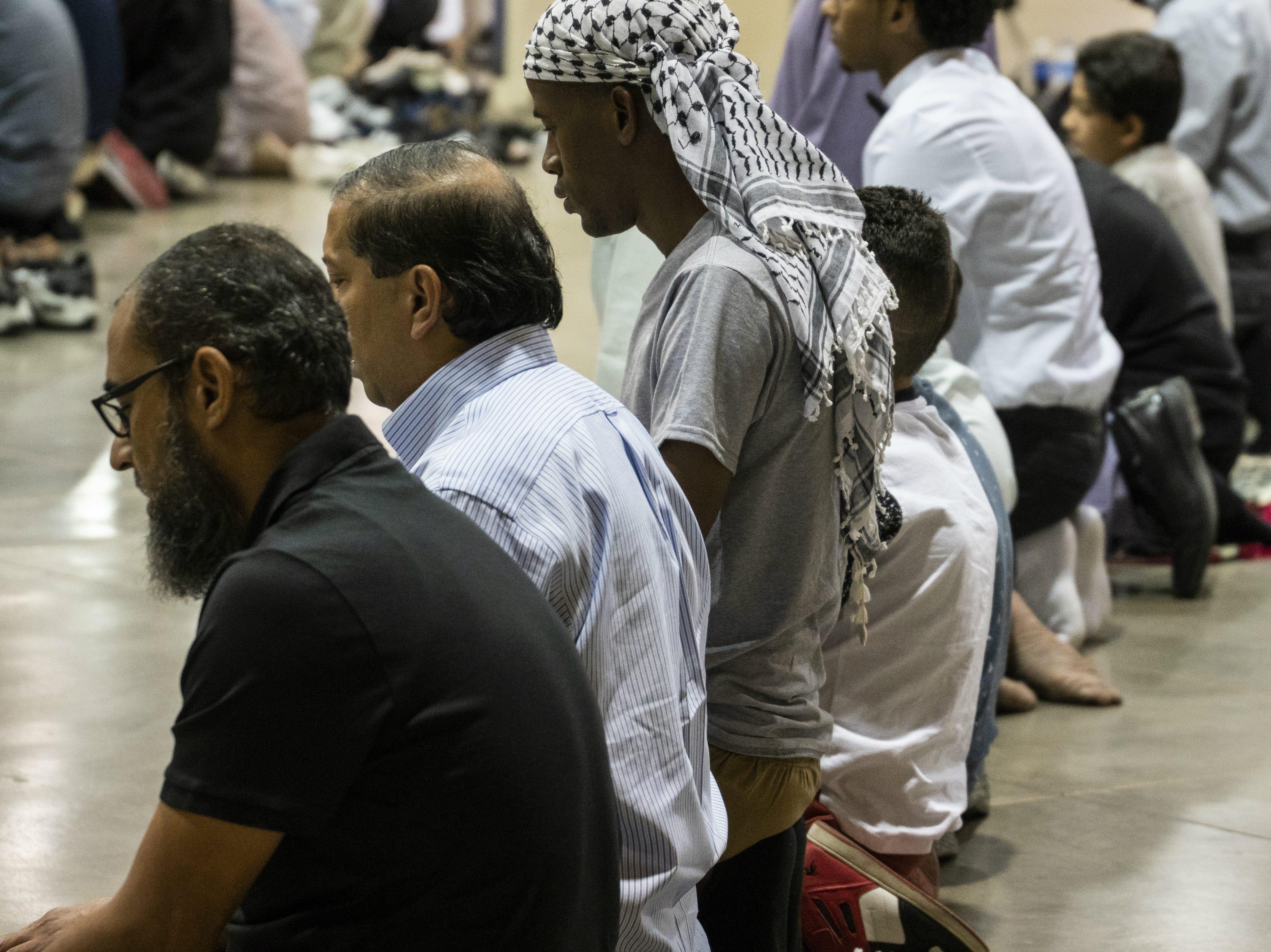 Men pray at an Eid celebration on Aug. 21, 2018, in Phoenix.