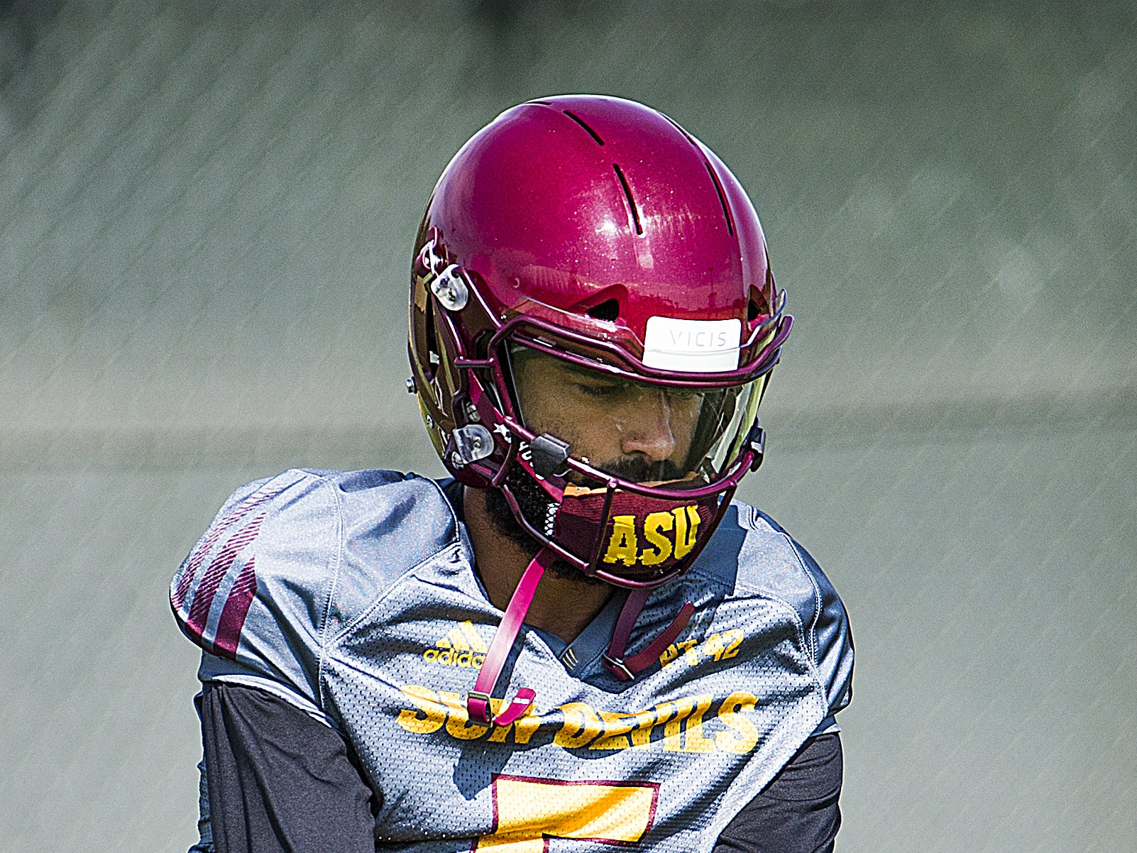 Arizona State University quarterback Manny Wilkins takes a snap during practice in Tempe, Tuesday, August 21, 2018.