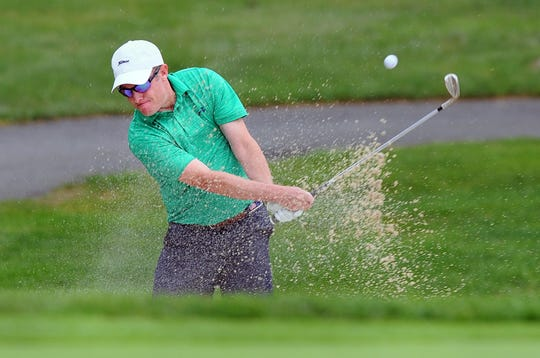 Chris Gebhard hits his 2nd.shot from a green side bunker on the 12th. hole during Monday's finish of the 2018 W.B. Sullivan Four-ball Invitational at the Lebanon Country Club.