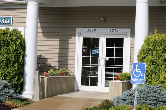 By 9:30 a.m. Tuesday, the offices of Catawba Dental had closed. However, law enforcement officers were still walking in and out of the building.