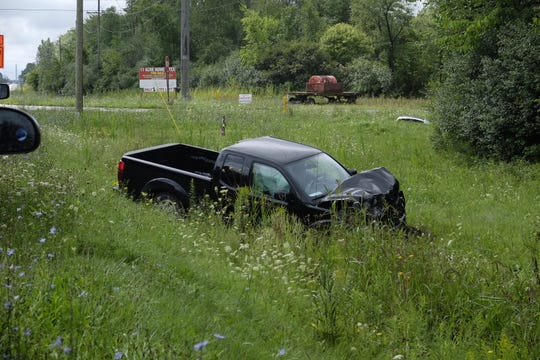 A truck sits in the grass off Range and Davis roads following a crash Tuesday in Marysville.