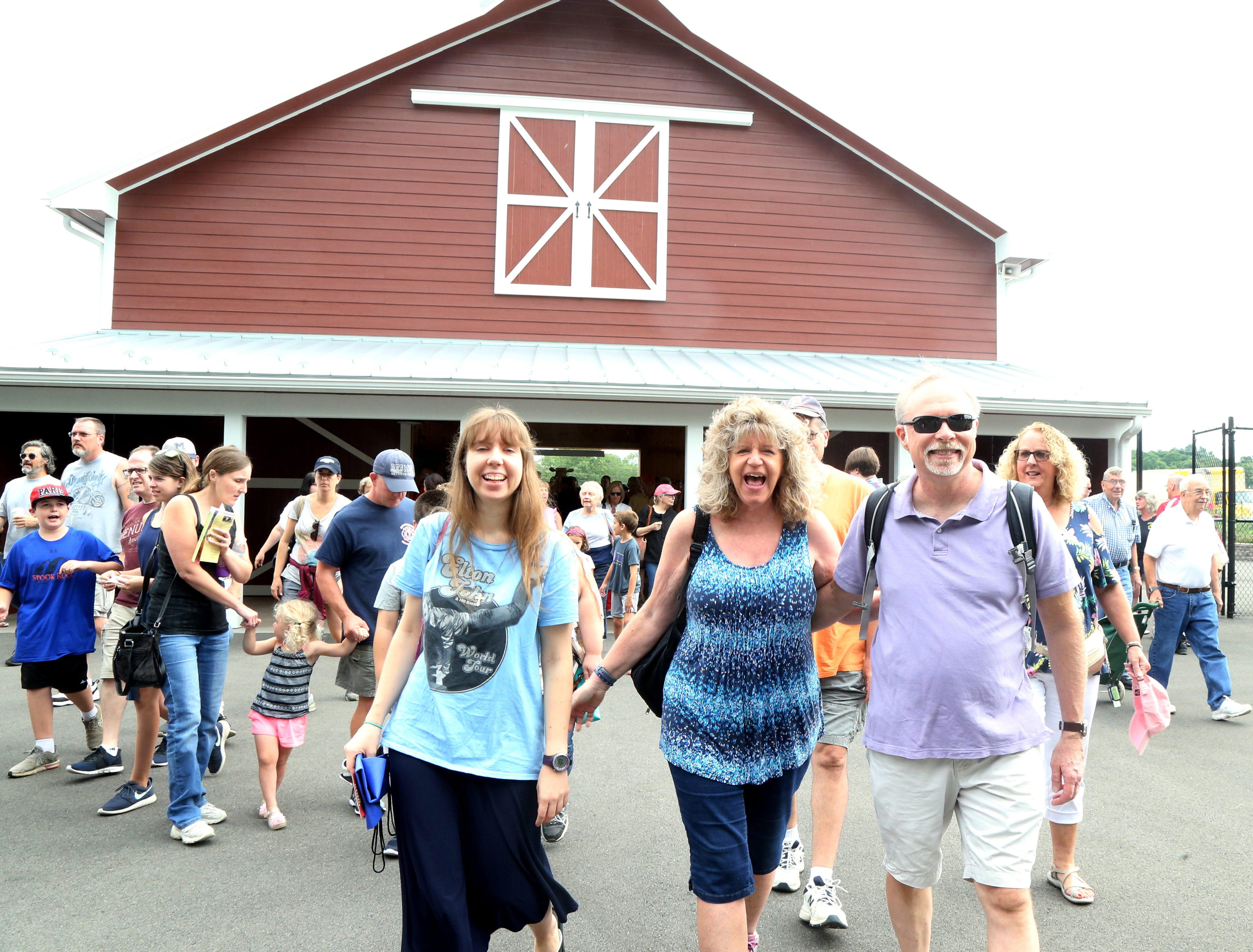 From left Liz, Chris and Bill Fitzpatrick of Poughkeepsie enter the fairgrounds on the opening day of the Dutchess County Fair in Rhinebeck on August 21 2018.