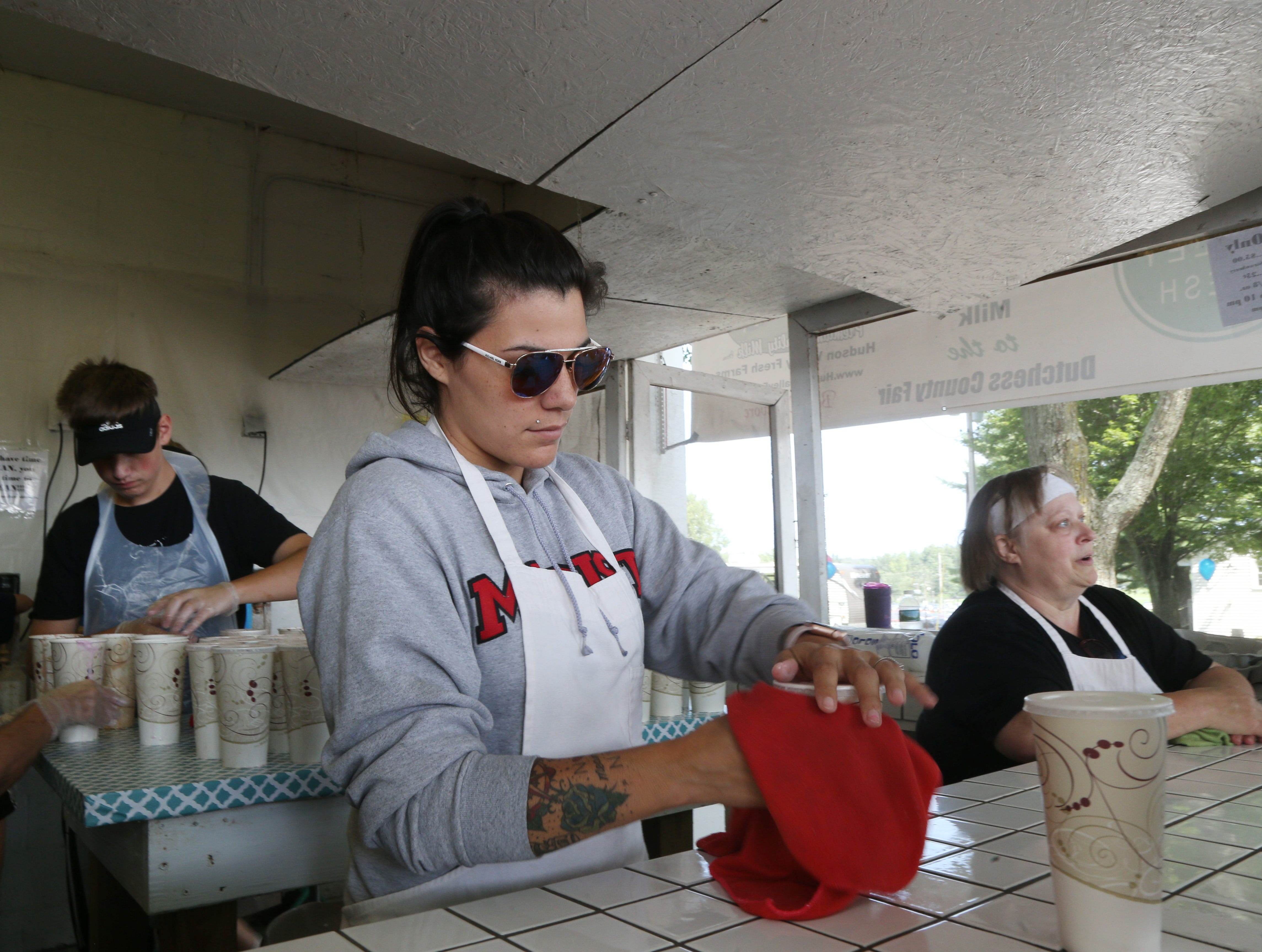 Samantha Salat or Rhinebeck puts the finishing touches on milkshakes at the Dutchess County Fair in Rhinebeck on August 21 2018.