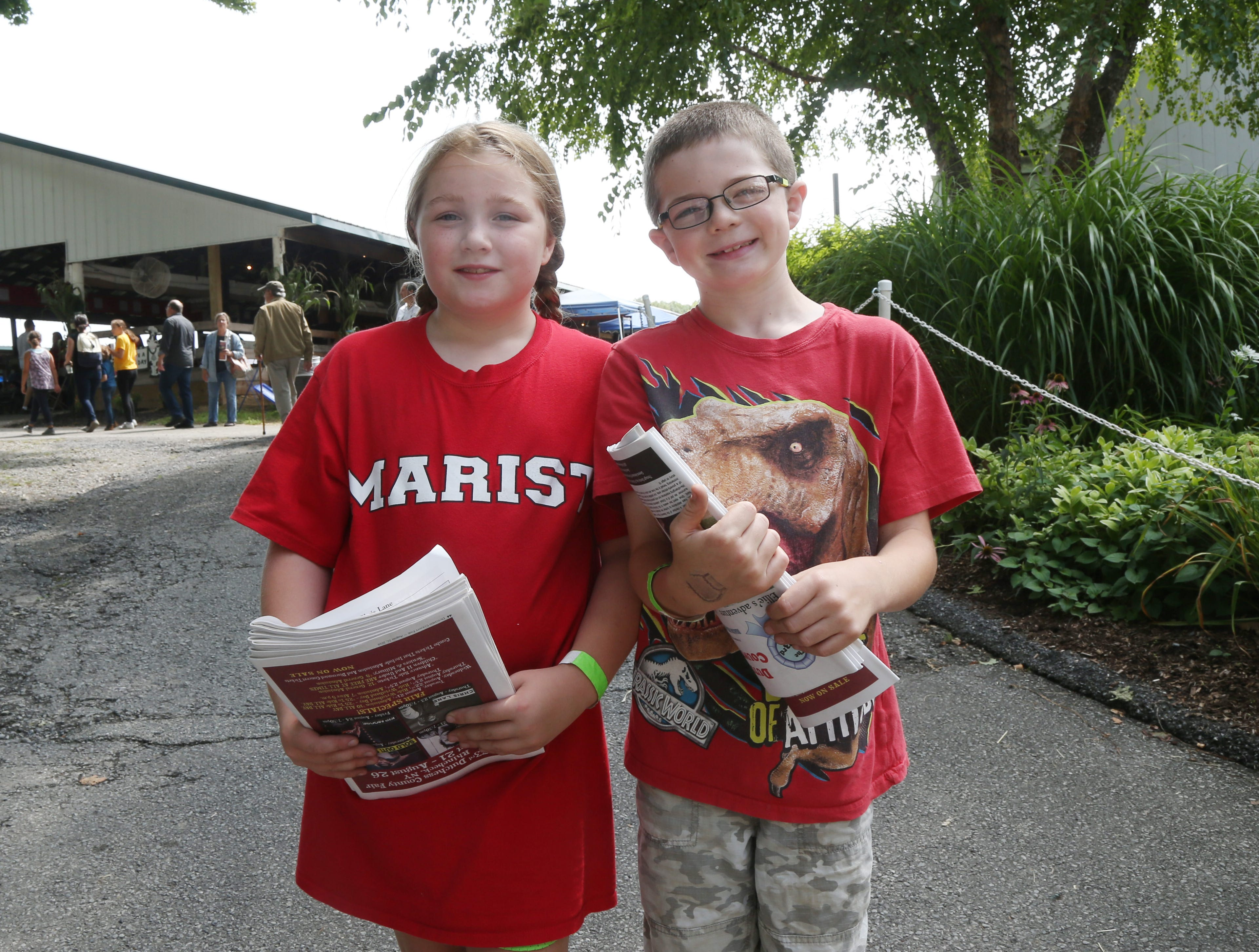From left, Jenna  Lawrence of Wappingers Falls and Kogan Lawrence of Amenia hand out newsletters at the Dutchess County Fair in Rhinebeck on August 21 2018.