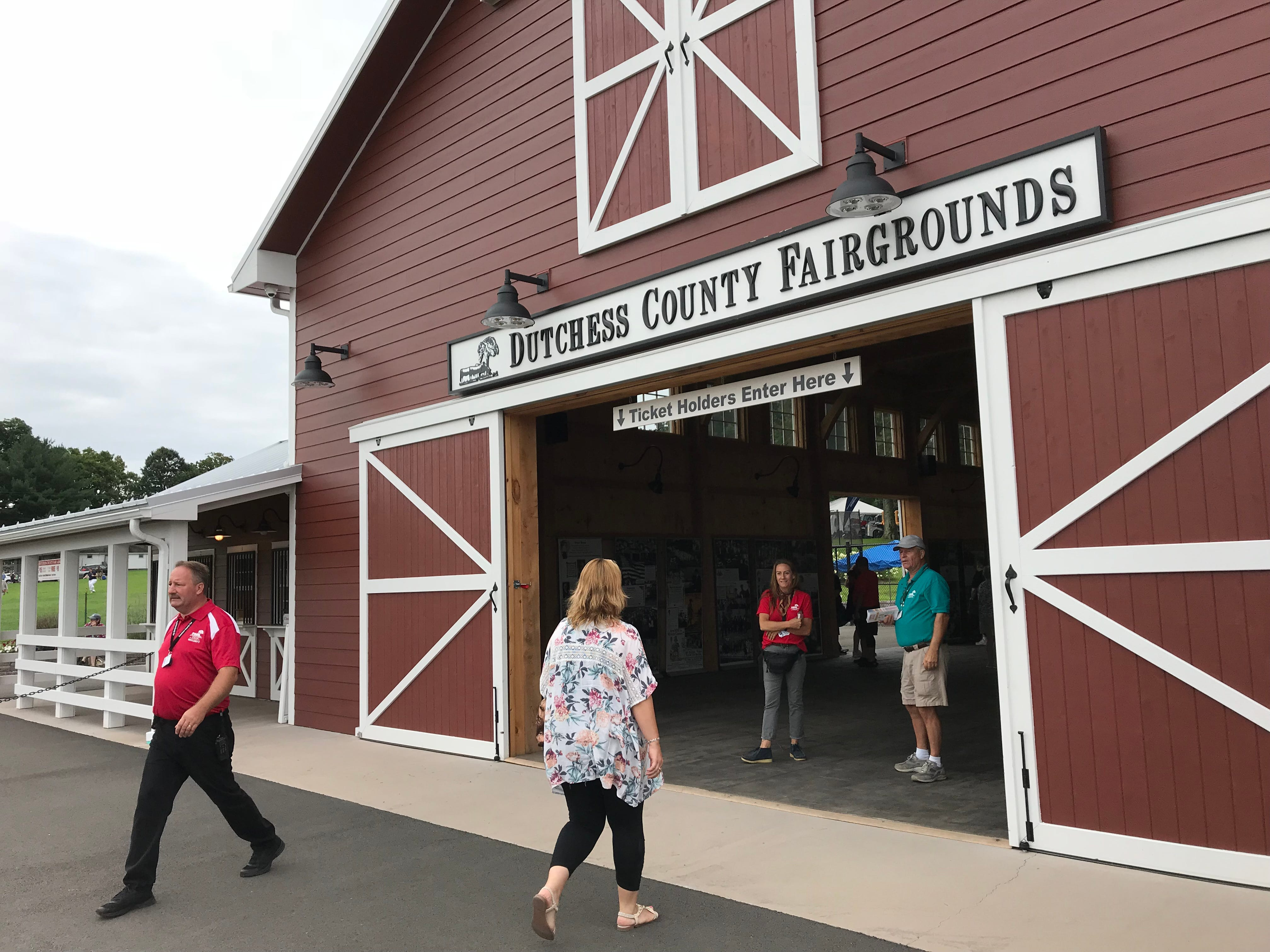 A visitor approaches the entrance to the  Dutchess County Fair before it opened Tuesday morning.