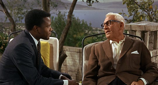 "Sidney Poitier, left, and Spencer Tracy are shown in a scene from the 1967 film ""Guess Who's Coming to Dinner."""