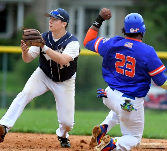 East Prospect's Dalton Renn takes the late throw as Hallam's Xavier Bonilla steals second during game one of the Susquehanna League championship at East Prospect Tuesday, August 21, 2018. Bill Kalina photo