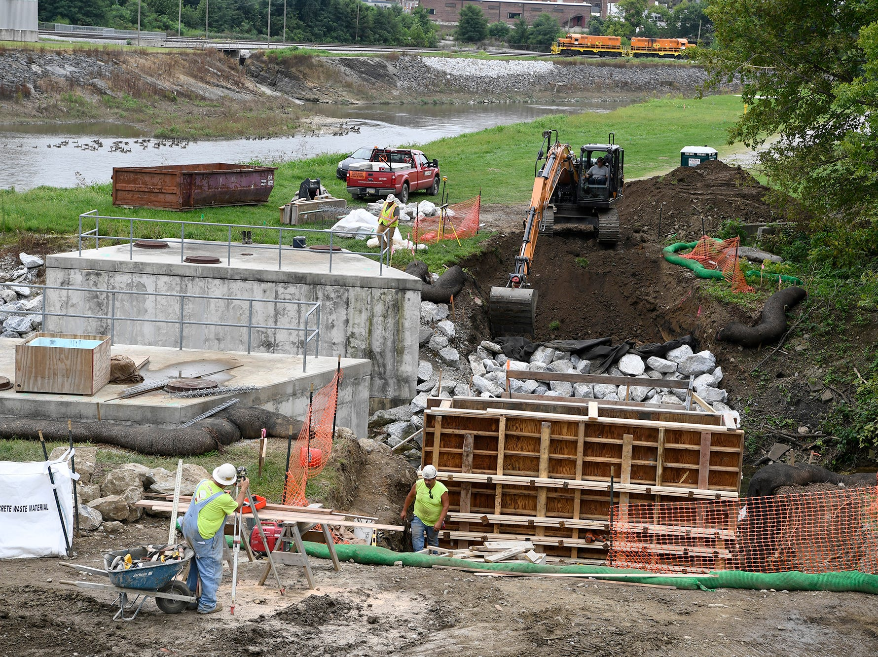 A crew from Kinsley Construction works on excavating and constructing a pedestrian bridge over Willis Run for the new York County Heritage Rail Trail section that will connect York City and the northeast extension all the way to John Rudy Park, Tuesday, August 24,  2018. John A. Pavoncello photo