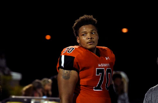 In this Sept. 16, 2016, photo, then-McDonogh high school football lineman Jordan McNair watches from the sideline during a game in McDonogh, Md.