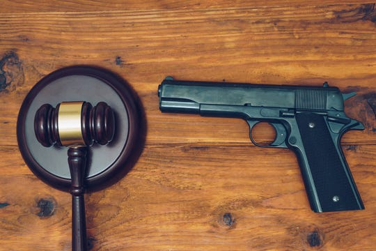 Judge's gavel and handgun; stock image.