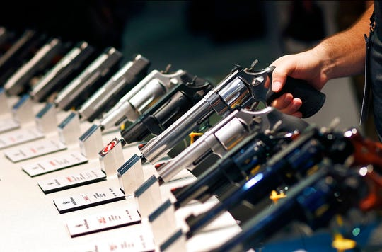 In this Jan. 19, 2016 file photo, handguns are displayed at a trade show in Las Vegas.