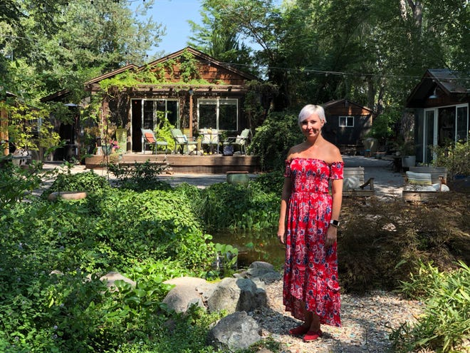 Yeliz Berg, new business tenant of the Sierra Water Gardens, poses in the backyard pond area. Berg plans to make the business into more of a multi-purpose event space instead of a garden nursery.
